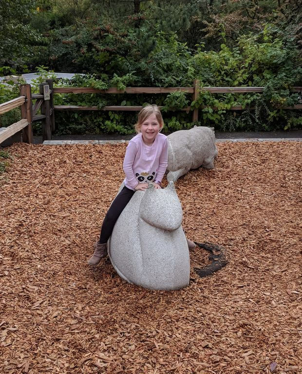 Cadence playing on a giant snail sculpture